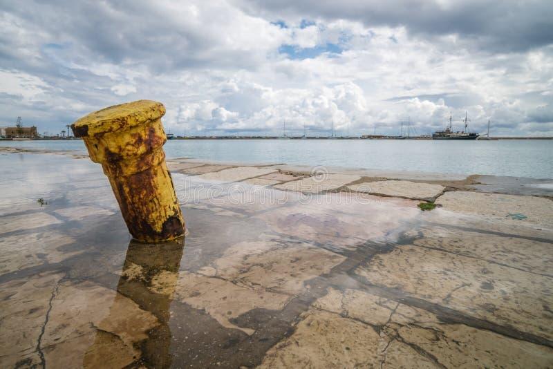 Metal anchoring bollard in Zakynthos Town. Steel anchoring bollard on the shore in the beautiful Zakynthos town, Greece stock photo