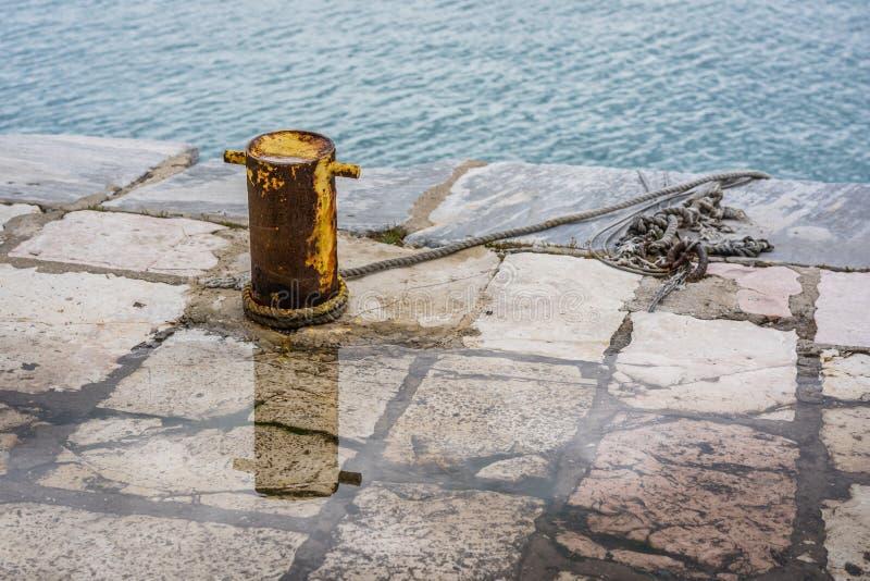Metal anchoring bollard in Zakynthos Town. Steel anchoring bollard on the shore in the beautiful Zakynthos town, Greece stock photography