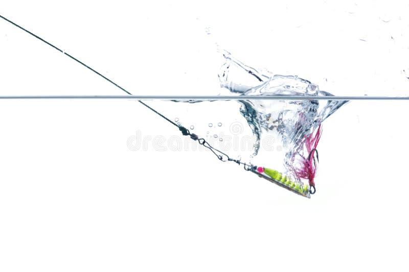 Metal angling bait. Metal angling falling to water bait royalty free stock image