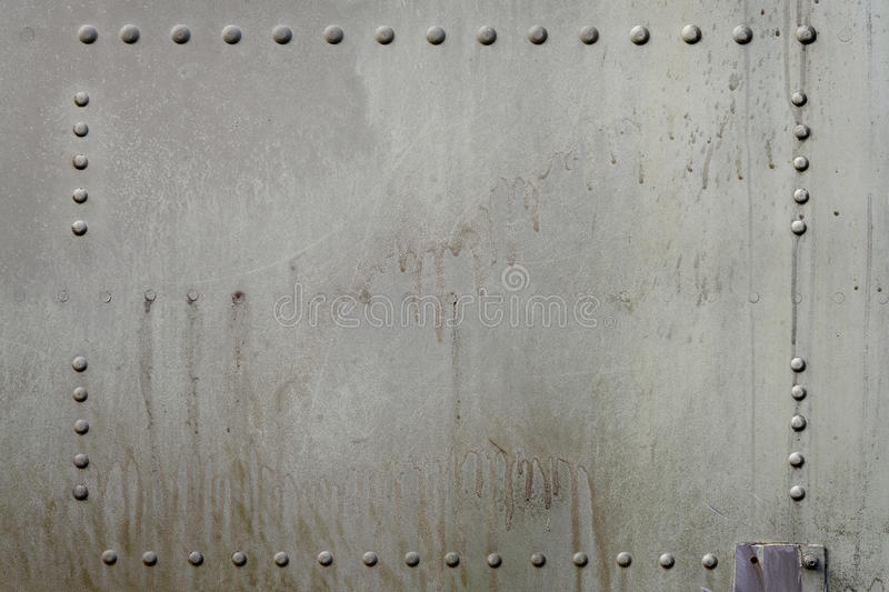 Metal Background. Old metal surface of riveted metal from aircraft royalty free stock photography