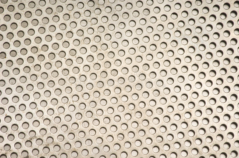 Metal Background Pattern. Hole Punched Pattern Metal Background royalty free stock photography