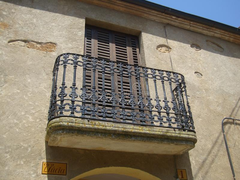 Metal balcony railing. Metal wrought iron balcony railing stock photo
