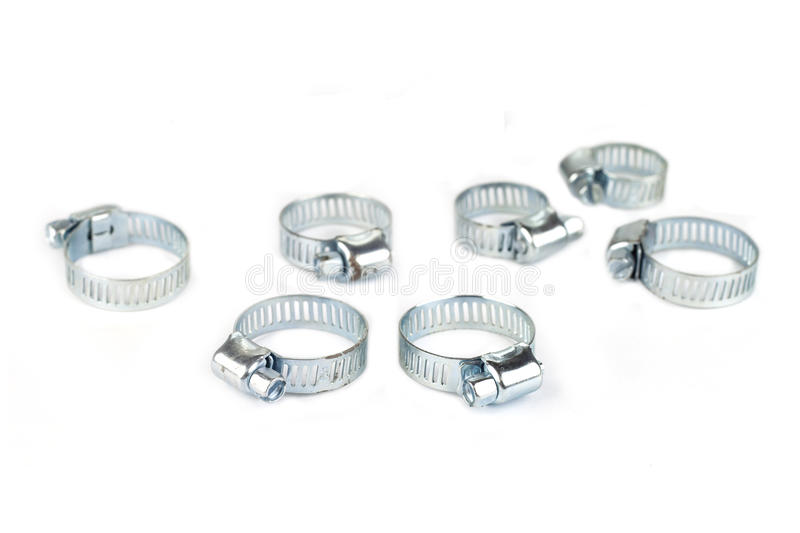 Metal band hose clamp. Isolated on white background stock photos