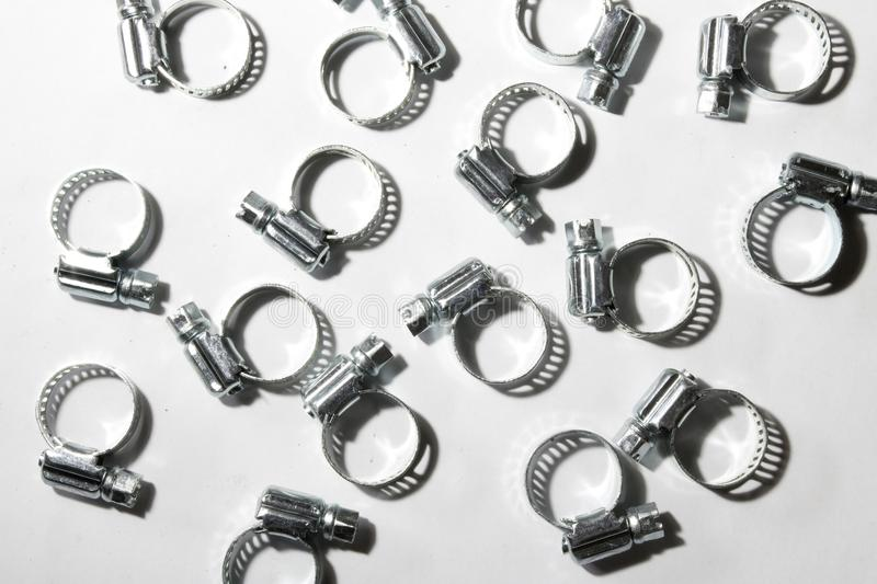 Metal band hose clamp on white background. Metal band hose clamp isolated on white background closeup royalty free stock photo