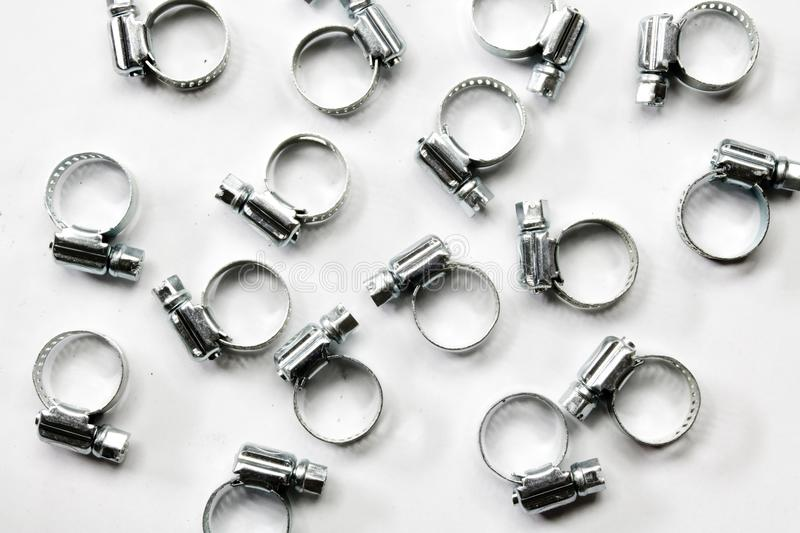 Metal band hose clamp on white background. Metal band hose clamp isolated on white background closeup stock images