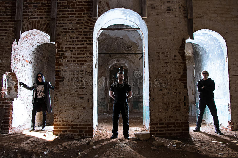 Metal band in temple. Photo of rock band in cathedral stock photography