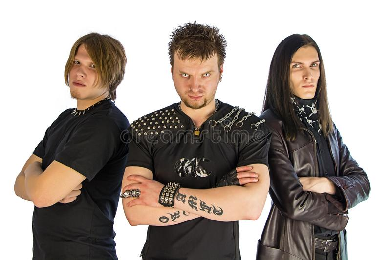 Metal band. Three guys metal band in black - isolated photo stock photography