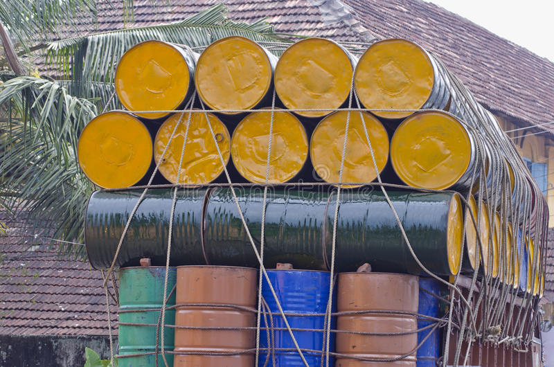 Metal barrels stacked atop truck, south india stock images
