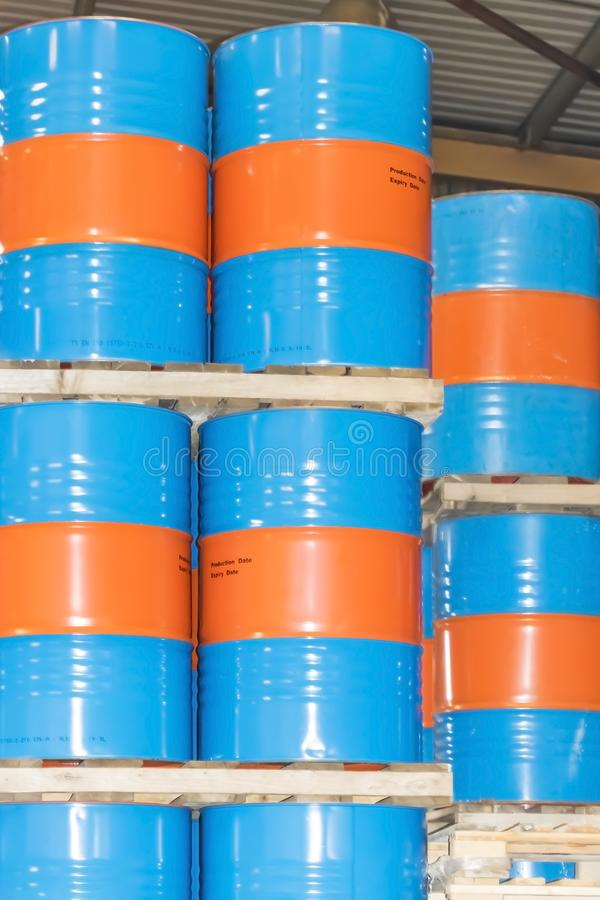 Metal barrels for storage and transportation of orange oil in the warehouse of canning orange factory or plant.  royalty free stock photos