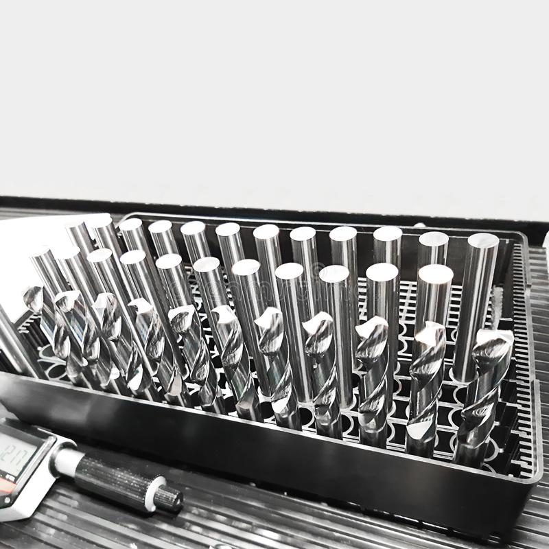 Metal base bar for making twist drills. Square shot with copy space for design about tools and instruments royalty free stock image