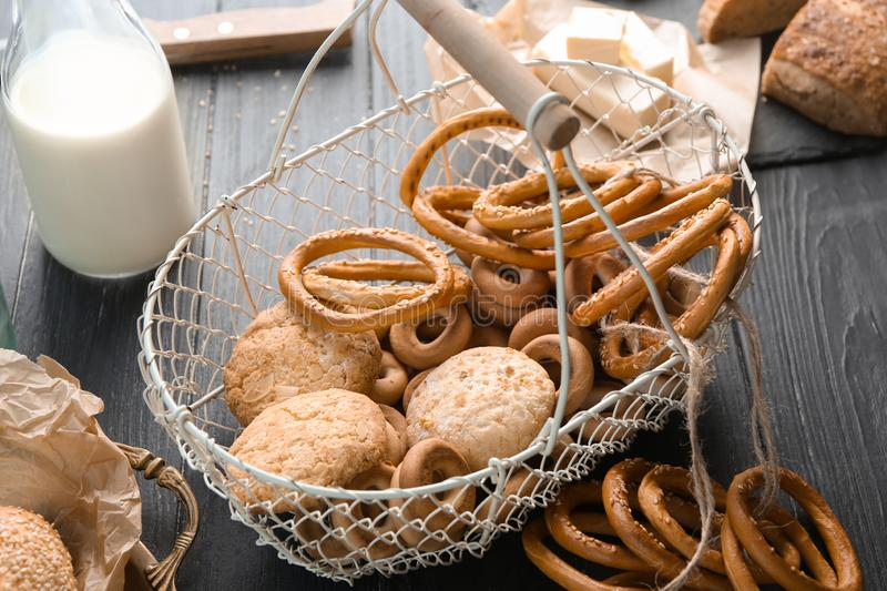 Metal basket with different bakery products on table stock images