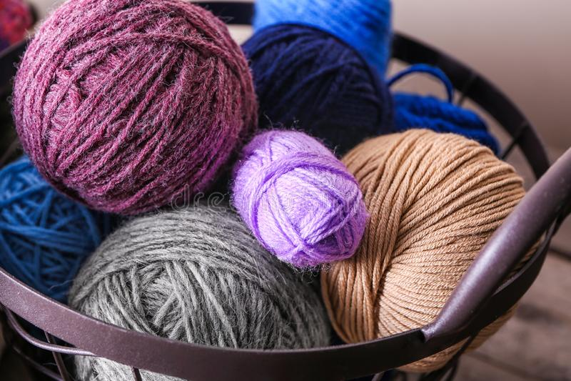 Metal basket with knitting yarn, closeup stock photo