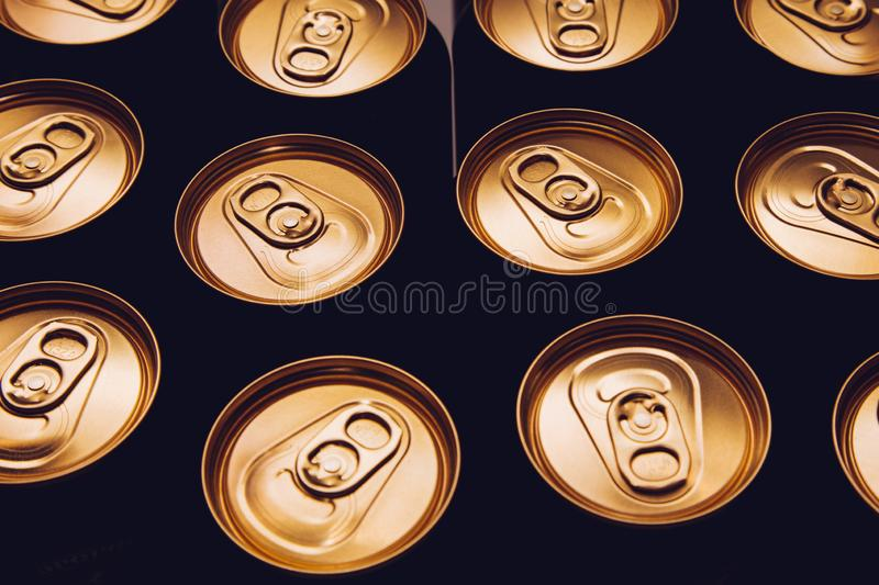 Metal beer cans background black gold stock image