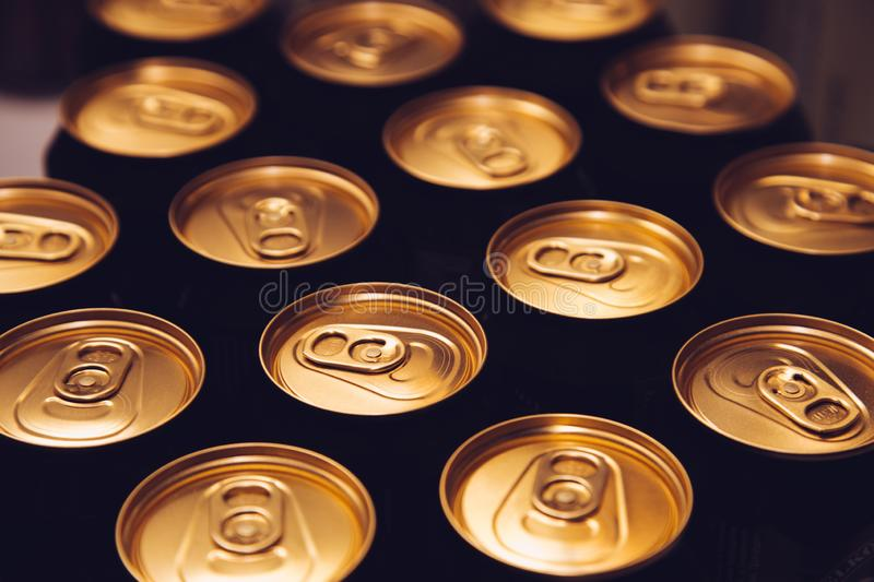Metal beer cans background black gold stock photos