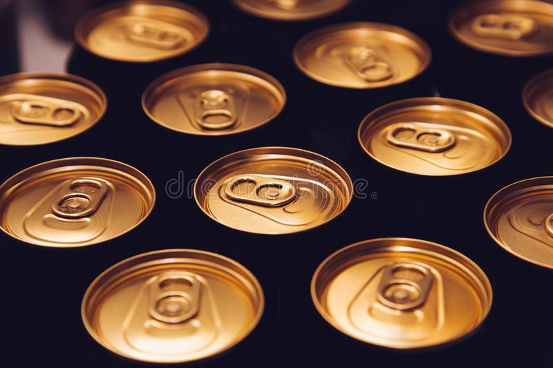Metal beer cans background black gold stock photography