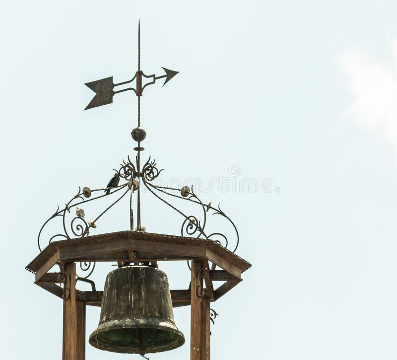 Metal bell with weather vane stock photos