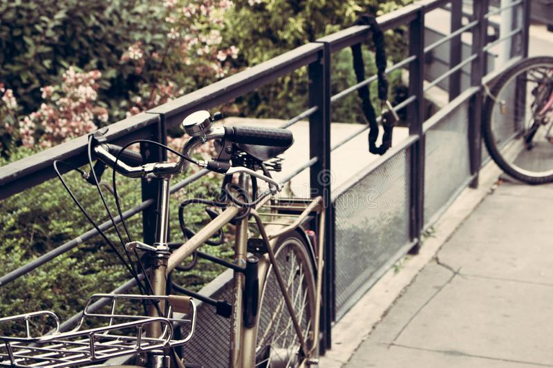 Metal bike hanging on a fence stock photo