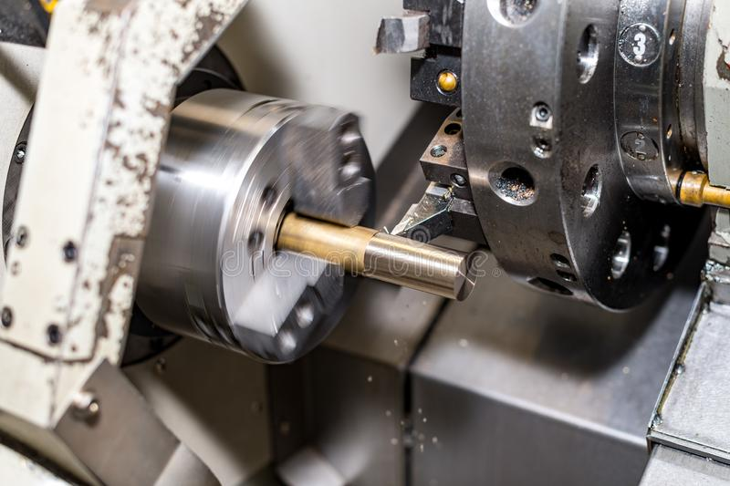 Metal blank machining process on lathe with cutting tool royalty free stock images