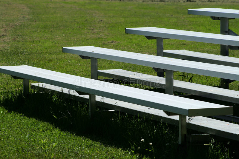 Metal Bleachers in the Park. Metal bleachers at the baseball diamond in the park royalty free stock photo