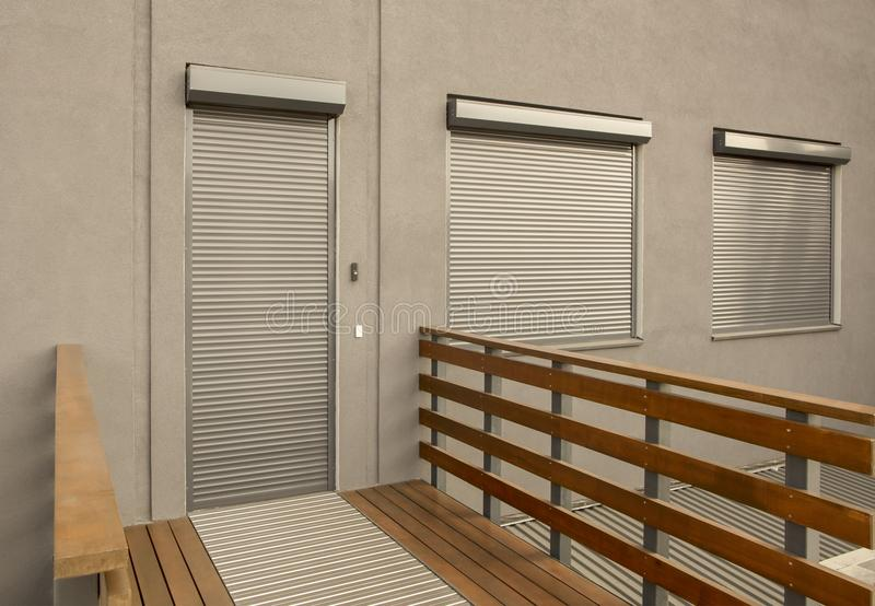 Metal blinds on the doors and windows of the facade of the house royalty free stock photos