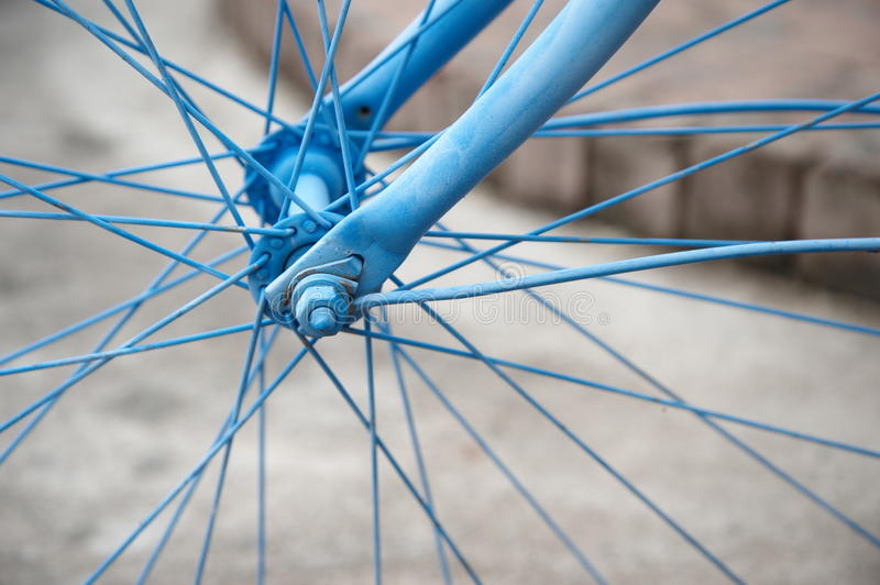 Metal blue bicycle wheel background stock photography