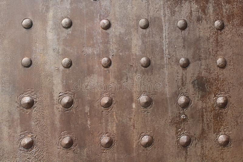 Metal board with round spikes pattern stock photos