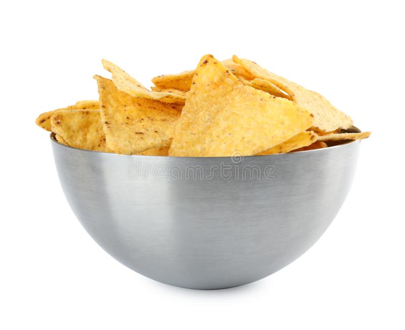 Metal bowl with tasty Mexican nachos  on white background royalty free stock photography