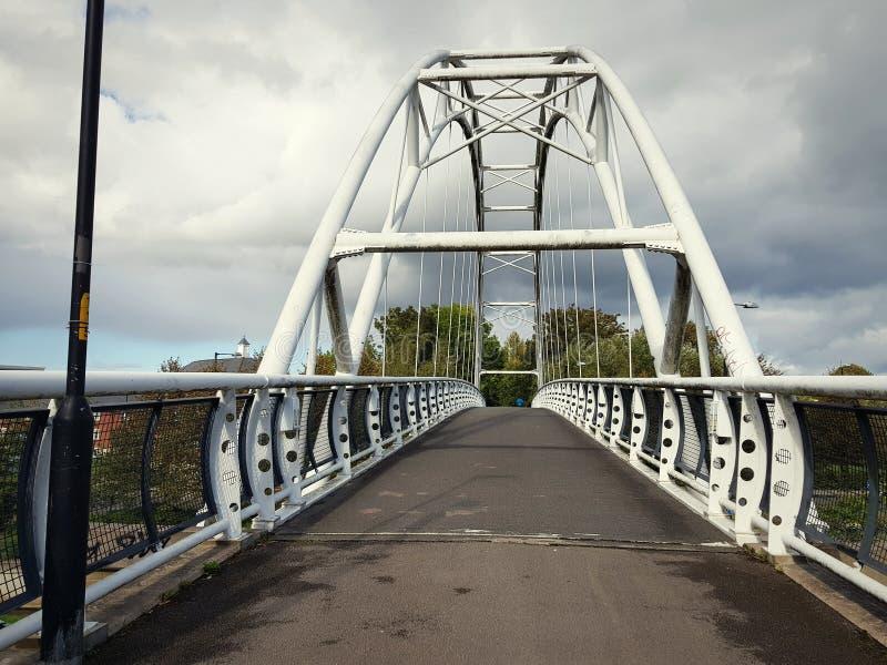 Metal bridge in Cheltenham, United Kingdom. Metalbridge, connection, modern, urban, way, going, pathway, forward stock images
