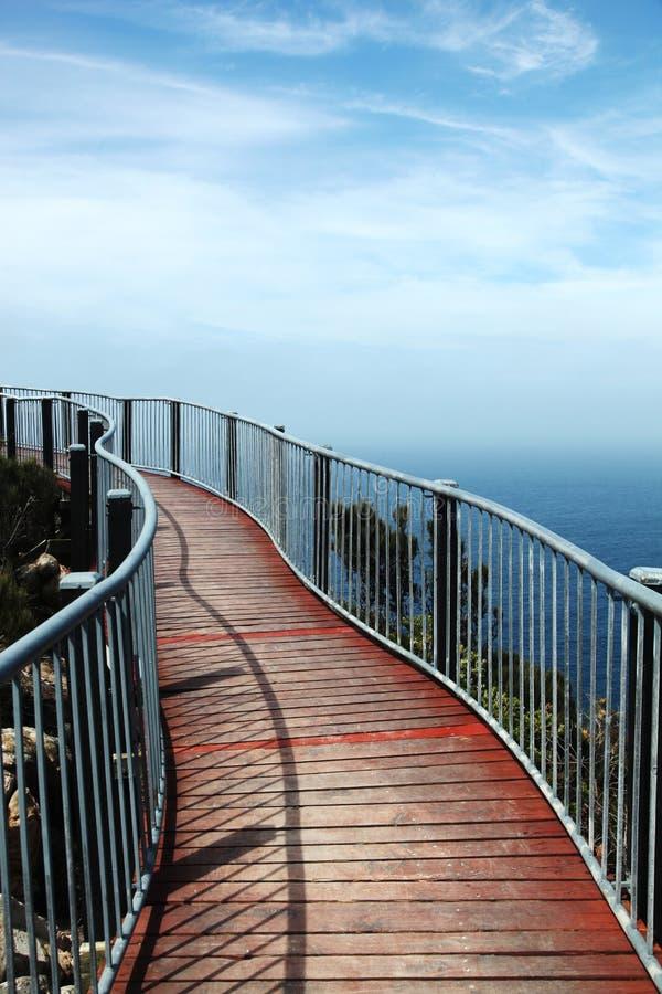 Metal bridge with wooden slats royalty free stock photos