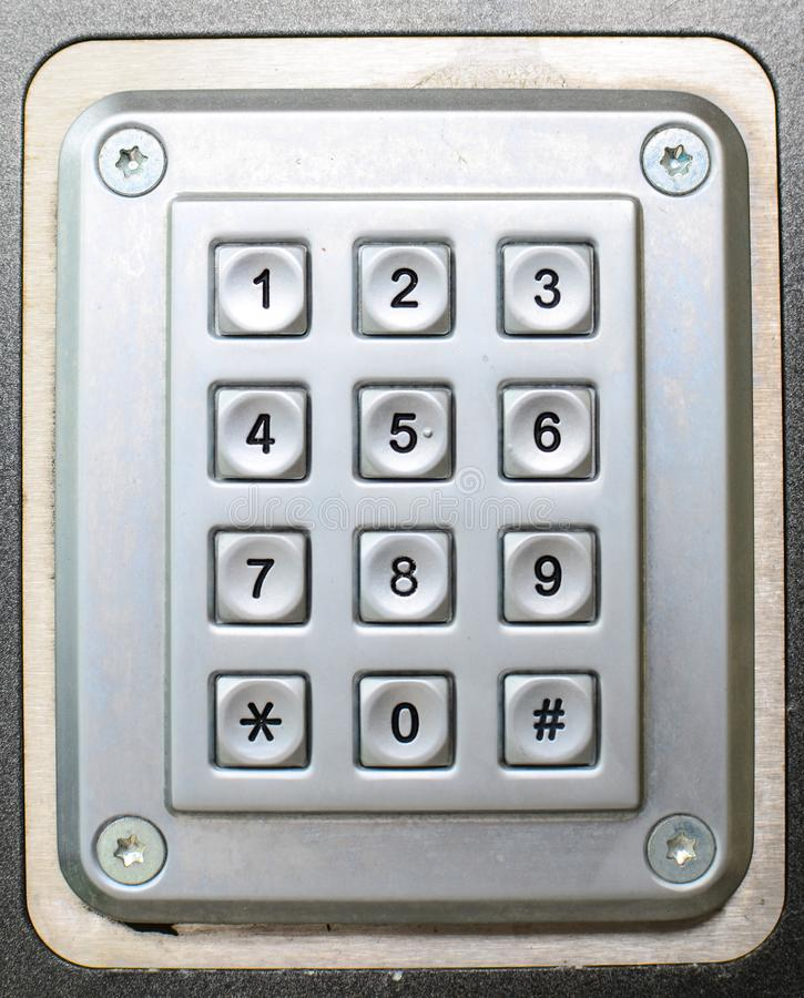 Metal button phone keypad background royalty free stock photography