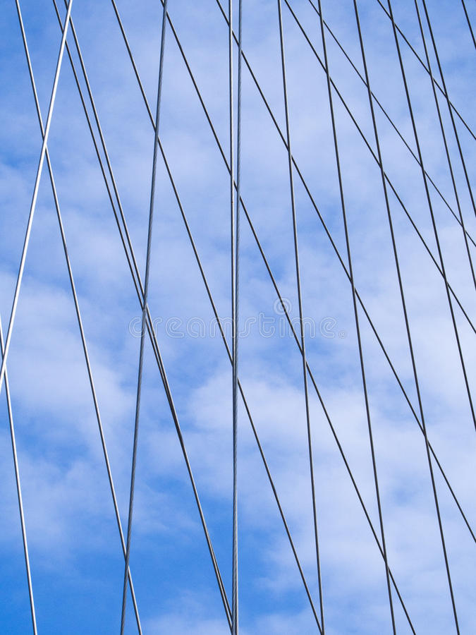 The metal cables of the London Eye against the blue sky royalty free stock photography