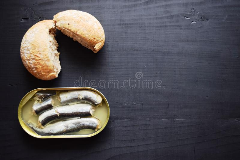 Metal can with conserved herring fish, canned marinated herring, open tin can , Top view. royalty free stock images