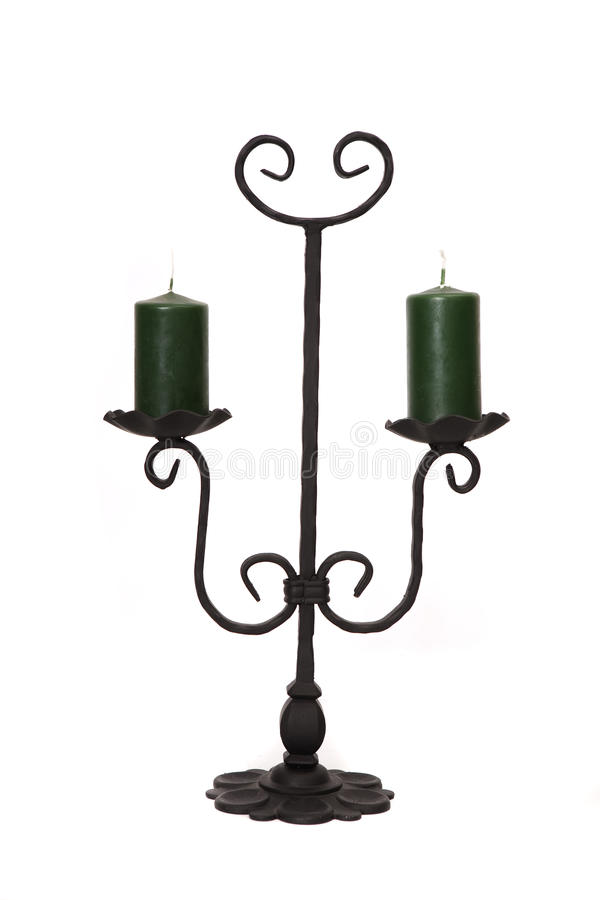 Metal candelholder with green candles stock photo