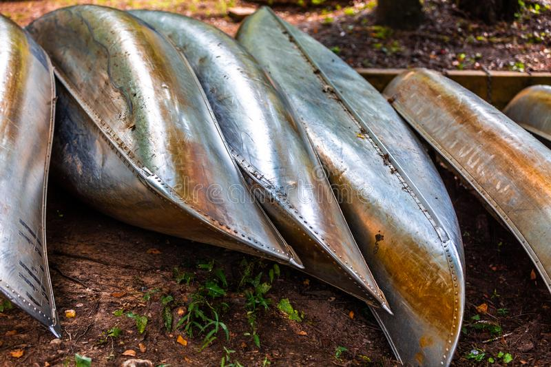 Metal Canoes along Lake Caddo in Texas. Metal canoes lined up at Caddo Lake for end of the season storage royalty free stock image
