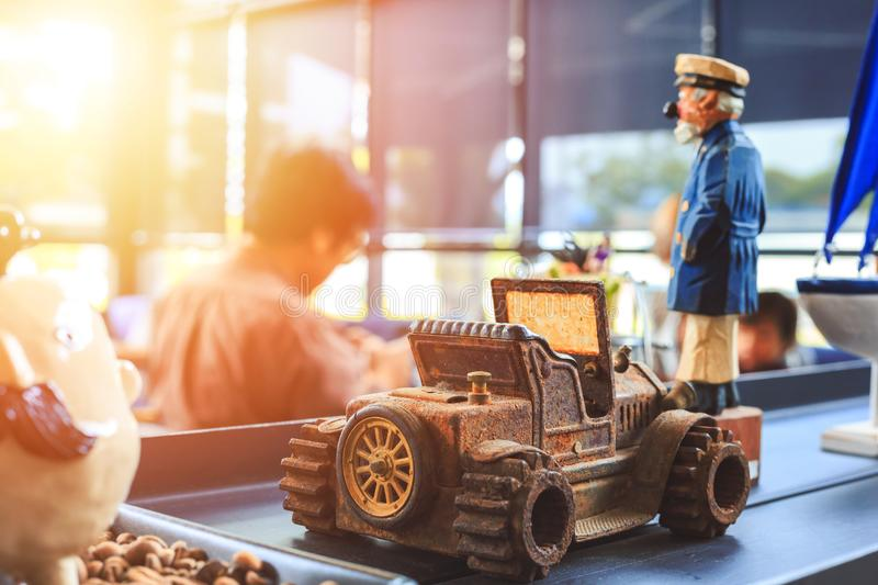 A Metal car toy on the table in the coffee shop. royalty free stock photo