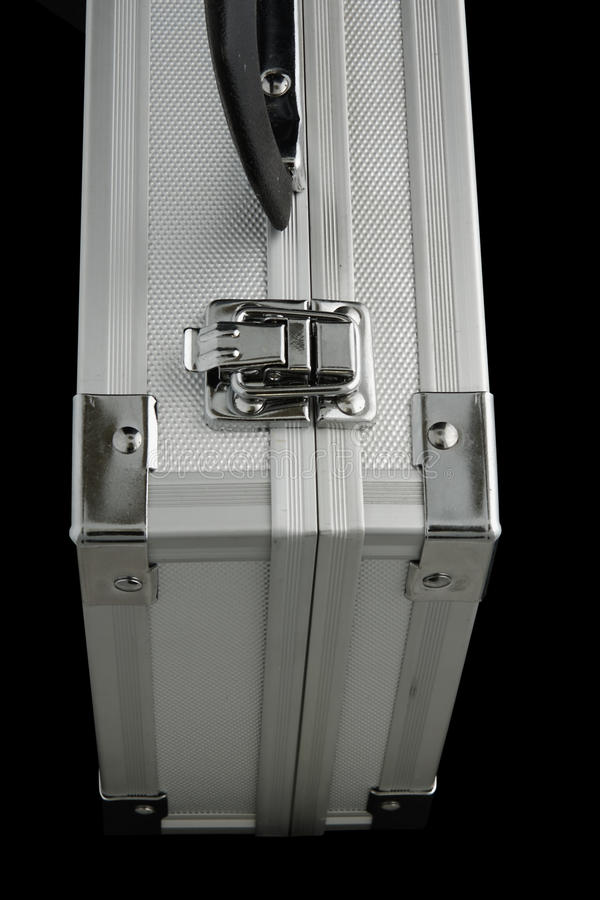 Metal case. Isolated on the black background stock image