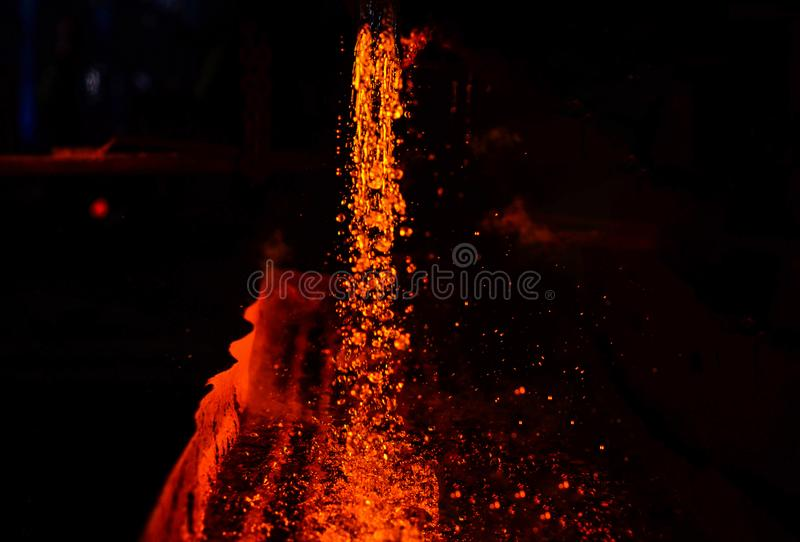 Use for abstract background and texture. Heavy industry metallurgical plant sparks stove metall. Metal on casting. Metallurgy. Use for abstract background and royalty free stock photo