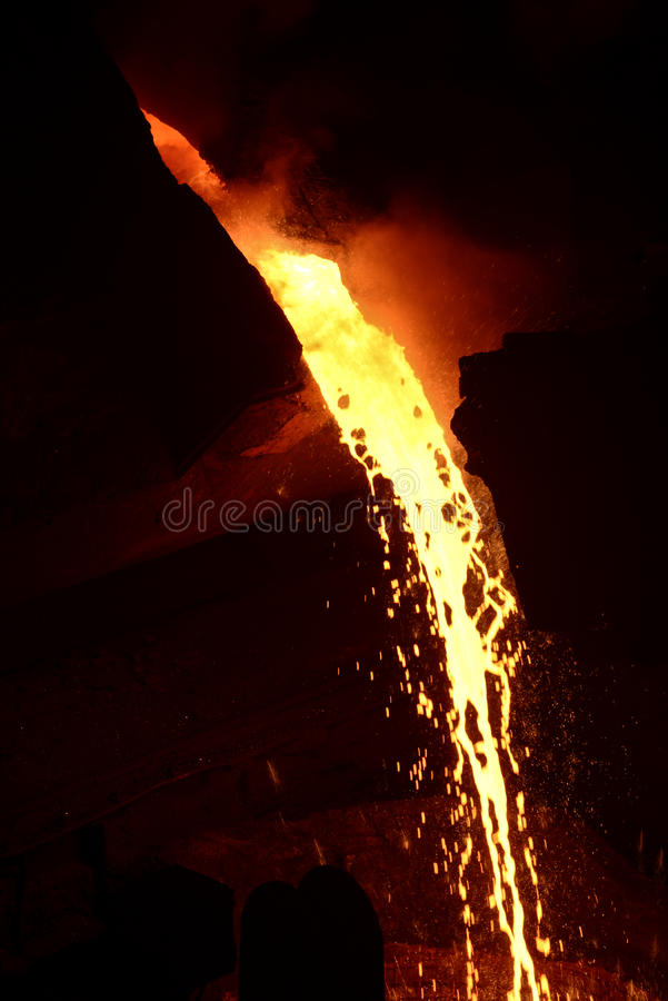 Metal casting process. With high temperature fire in metal part factory royalty free stock photo