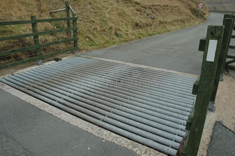 Metal cattle grid. / grate on farm to stop livestock escaping royalty free stock photography