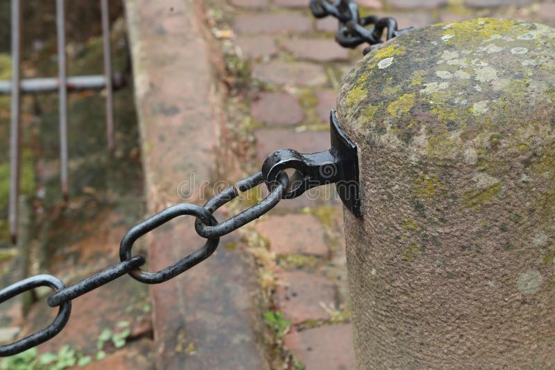 Metal chain guard. / Metal chain fence in the square stock photography