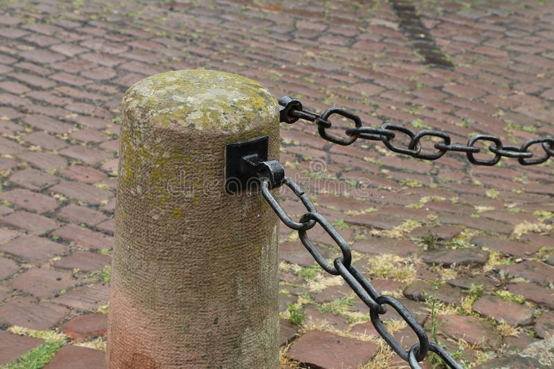 Metal chain guard. / Metal chain fence in the square royalty free stock images