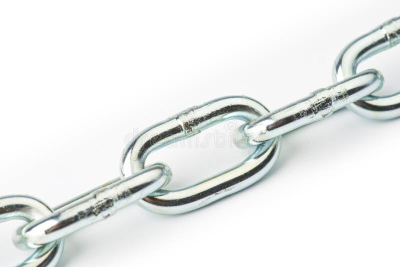 Metal chain links. Closeup on white stock image