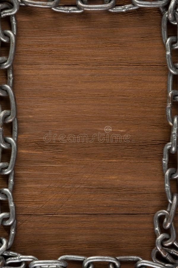 Metal chain on wood royalty free stock photos