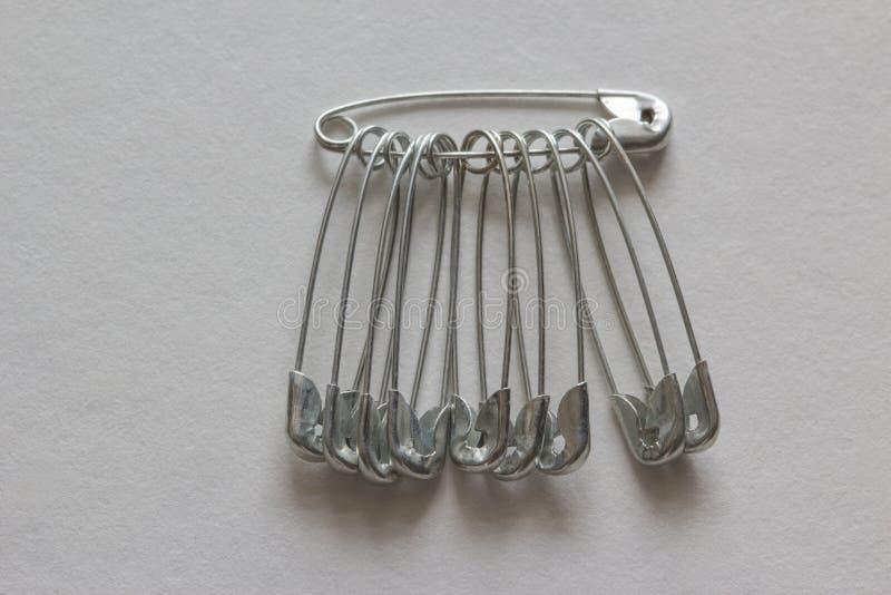 Metal chrome pins. On the white background stock photos