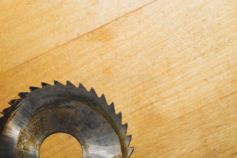 Metal circular saw blade on a wooden background. top view. working tool. carpentry instrument. Metal circular saw blade on a wooden background. top view. work stock photo
