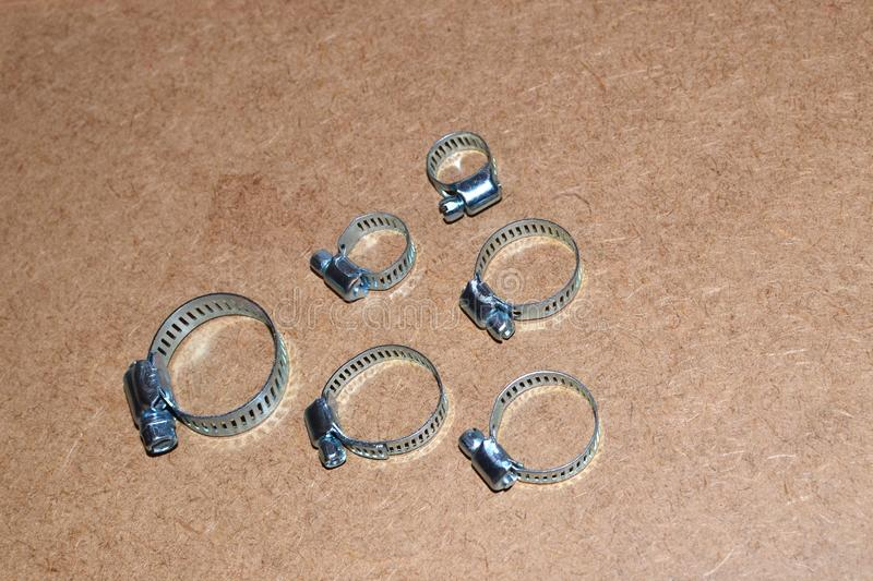 Metal clamps for hose connection isolated o stock photography