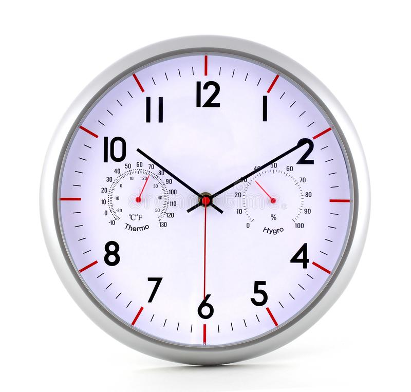 A metal clock with a stopwatch determines both the clock and the time. The clock is isolated on a white background. stock image