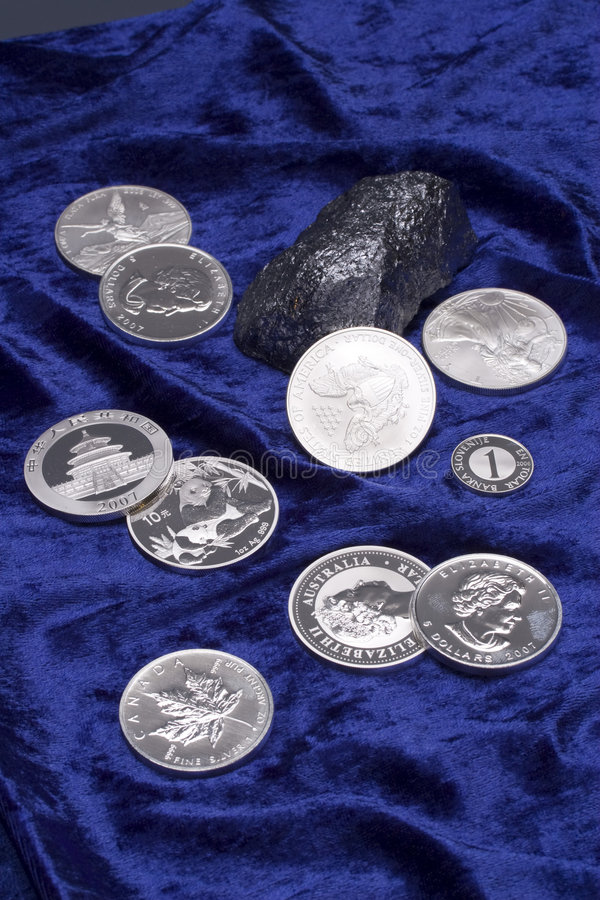 Metal coins. Diferent new clean metal coins royalty free stock photos