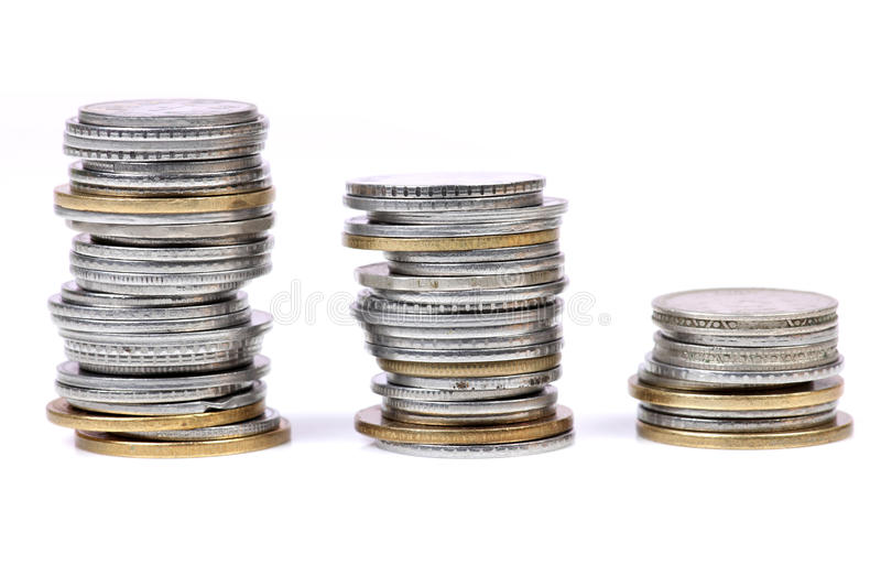 Metal coins. Beautiful shot of metal coins on white background royalty free stock images