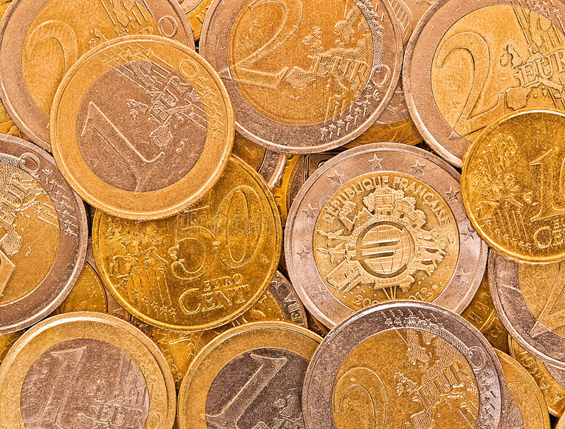 Metal coins of European Union. Coins of European Union: 1, 2 Euro and 10, 50 cents are on the table stock photo